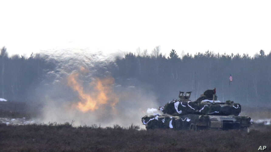 A U.S. Army tank joins the action during their exercise with Polish Army soldiers on training fields in Zagan, Poland, Jan. 30, 2017.