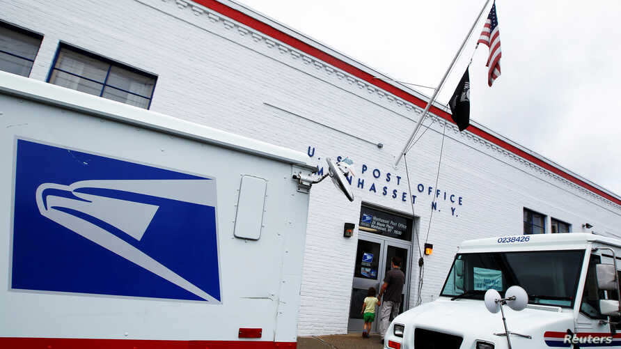 FILE - The entrance of a United States Post Office is seen in Manhasset, New York.