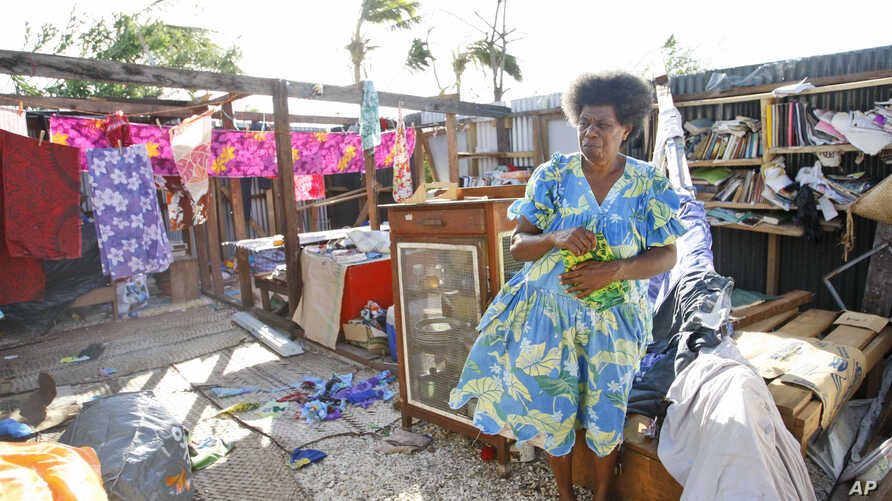Lisau Manses hangs laundry inside in the remains of her house on the island of Efate, Vanuatu, March 21, 2015.
