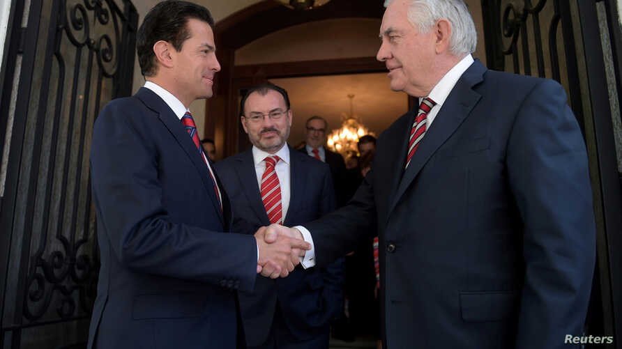 Mexico's President Enrique Pena Nieto shakes hands with U.S. Secretary of State Rex Tillerson at Los Pinos presidential residence in Mexico City, in this photograph from the Mexico Presidency, Feb. 2, 2018.