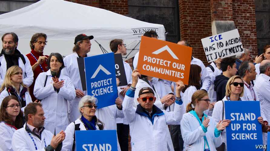 Researchers and supporters hold signs at a rally during the American Geophysical Union meeting in San Francisco, California, Dec., 2016.