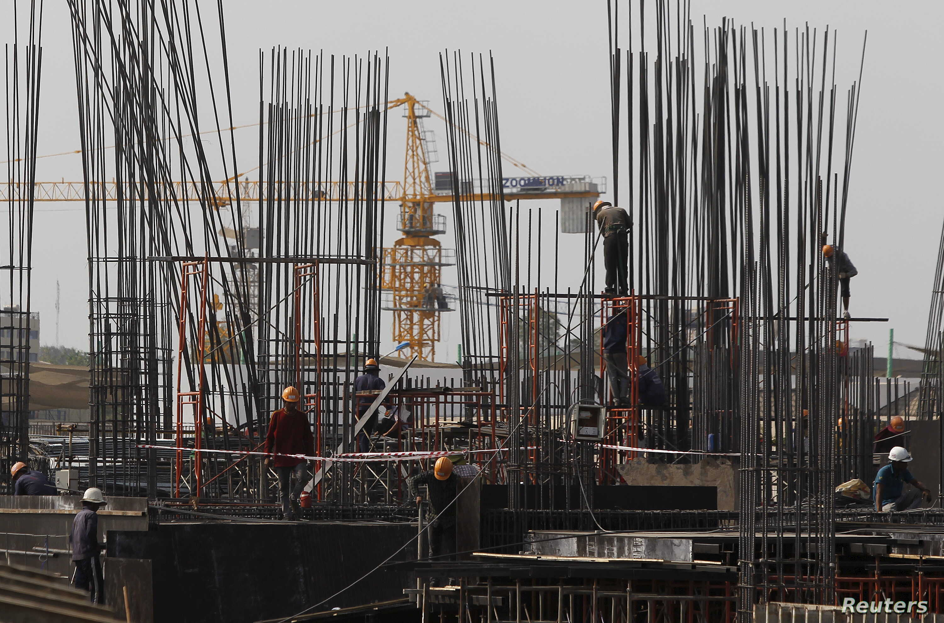 Laborers work at a construction site in Phnom Penh. Cambodia's economy is projected to expand by 7.3 percent in 2015, up from 7 percent in 2014, and will climb to 7.5 percent next year, Asian Development Bank (ADB) said in its Asian Development Outlo