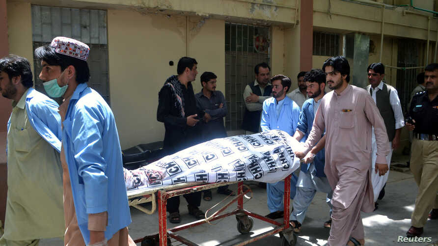 Hospital workers push a stretcher carrying the body of a policeman who was one of the policemen shot dead in Quetta, Pakistan, July 13, 2017.