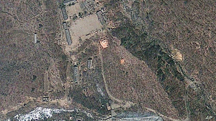 Satellite image provided by GeoEye appears to show a train of mining carts, at the lower center of the frame, and other preparations underway at North Korea's Punggye-ri nuclear test site but no indication of when a detonation might take place, April