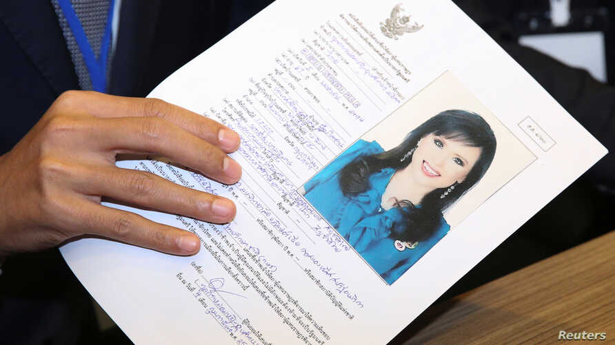 Thai Raksa Chart party leader Preechapol Pongpanich, holds up application of candidate for Prime Minister, Thailand's Princess Ubolratana Rajakanya Sirivadhana Barnavadi, at the election commission office in Bangkok, Thailand, Feb. 8, 2019.