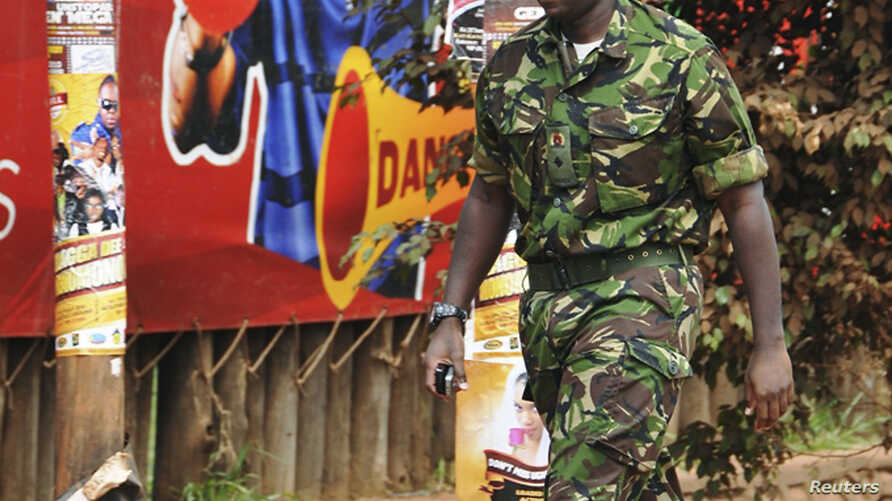 FILE - Muhoozi Kainerugaba, a son of Uganda's President Yoweri Museveni, has been promoted to the rank of major general, prompting speculation about possible future succession. He's shown in 2010.ampala July 12, 2010.