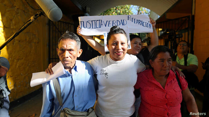 Teodora Vasquez, who in 2008 had been sentenced to 30 years in jail on charges of aggravated murder after inducing an abortion, walks out of jail accompanied by her parents after El Salvador's Supreme Court commuted her sentence, in Ilopango, El Salv