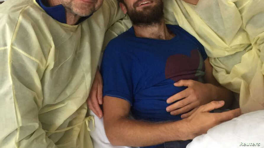 Pyotr Verzilov's parents visit him at Charite Hospital in Berlin, Germany, in this handout photo obtained Sept. 22, 2018. Cinema for Peace Foundation/Handout via Reuters.