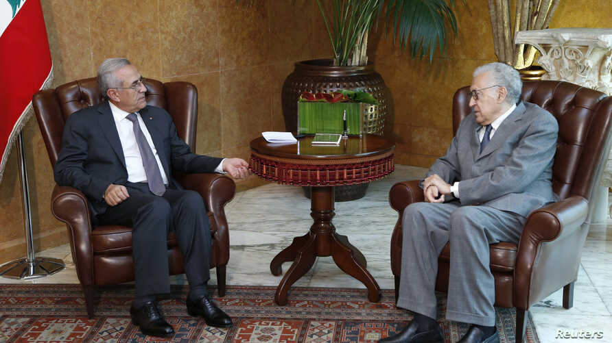 Lebanon's President Michel Sulaiman (L) meets with UN-Arab League peace envoy for Syria Lakhdar Brahimi at the presidential palace in Baabda, near Beirut, October 17, 2012.