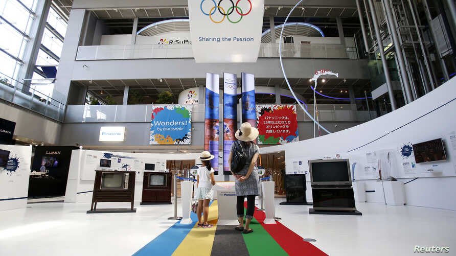Visitors look at an exhibition showing the history of the partnership between Panasonic Corp and Olympics at Panasonic centre in Tokyo, Aug. 6, 2014.