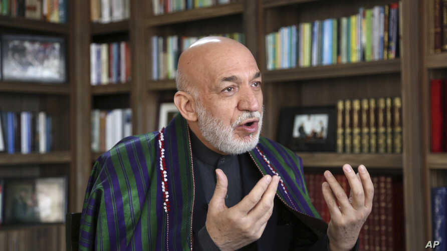 Afghanistan's former president Hamid Karzai speaks during an interview with the Associated Press in Kabul, Afghanistan, Feb. 7, 2018.