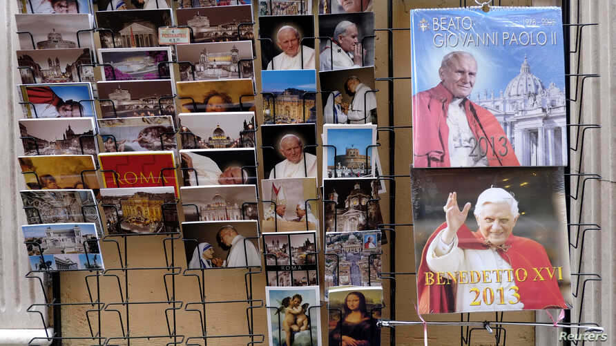 Postcards and calendars are displayed outside a shop at the Vatican February 12, 2013.
