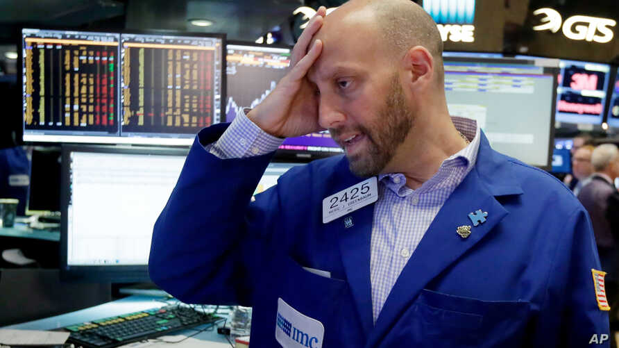 Specialist Meric Greenbaum works at his post on the floor of the New York Stock Exchange, June 24, 2016.