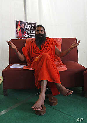 Yoga guru Baba Ramdev talks at the site of a Yoga camp he is likely to host later this week, in New Delhi, India, June 1, 2011.