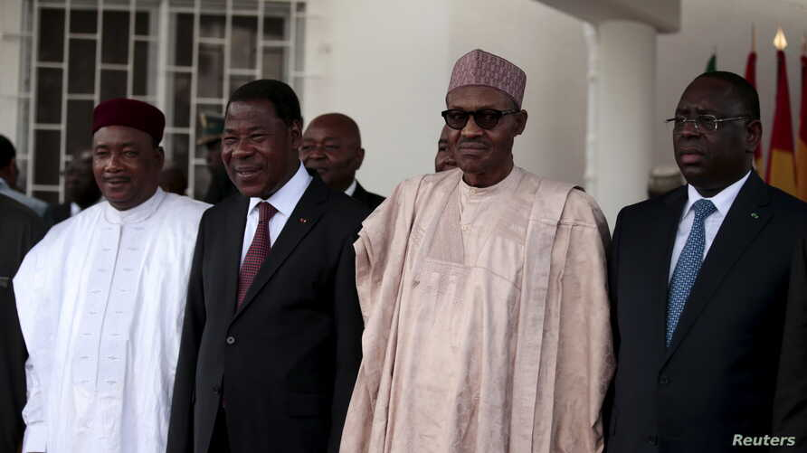 Niger's President Mahamaduo Issoufou, Benin's President Boni Yayi, Nigeria's President Muhammadu Buhari, and Senegalese President and Chairman of Economic Community of West African States (ECOWAS) Macky Sall attend an ECOWAS heads of state summit on