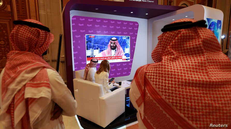 Participants watch on TV, as Saudi Crown Prince Mohammed bin Salman delivers a speech during the Future Investment Initiative Forum in Riyadh, Saudi Arabia, Oct. 24, 2018.
