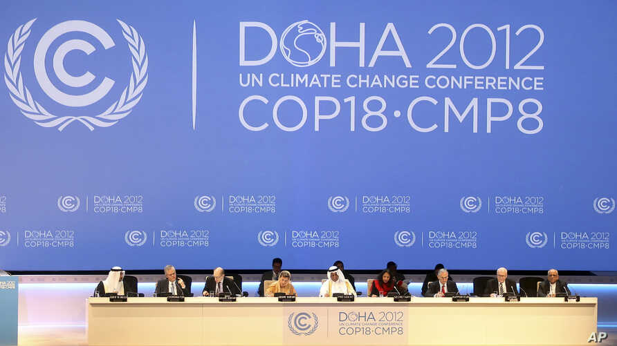 Organizers are seen on stage at the opening ceremony of the 18th United Nations climate change conference in Doha, Qatar, Nov. 26, 2012.