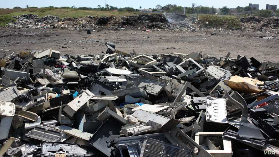 Plastic parts of obsolete electronics are pictured in a pile of refuse, in the Agbogbloshie neighborhood of Accra, Ghana, on Oct. 27 , 2014. (Chris Stein/VOA)Plastic parts of obsolete electronics are pictured in a pile of refuse, in the Agbogbloshie ...