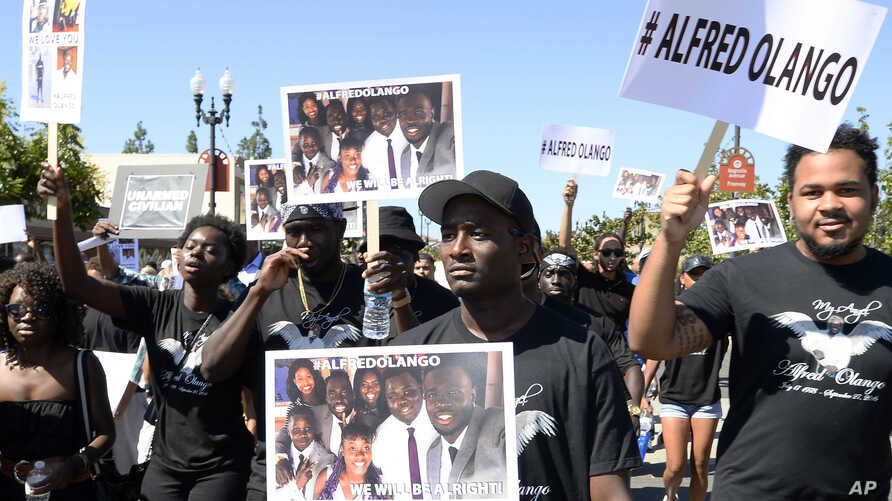 Protesters march through downtown El Cajon, Calif., Oct. 1, 2016, in reaction to the fatal police shooting of unarmed black man, Alfred Olango. Olango was a Ugandan refugee who arrived in the U.S. as a boy.