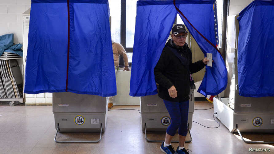 FILE - A voter leaves a polling booth during the U.S. presidential election in Philadelphia, Pennsylvania, Nov. 8, 2016.