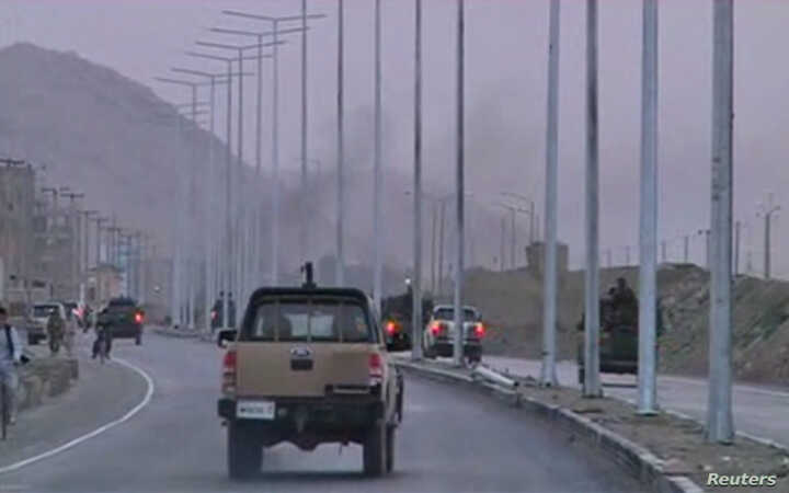 Security vehicles rush towards smoke rising in the distance, as an area near the Kabul airport comes under attack, in this still image taken from a Reuters TV video in Kabul, July 17, 2014.