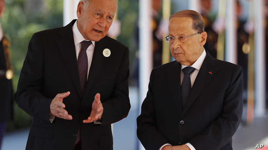 Arab League Secretary-General, Ahmed Aboul Gheit, left, speaks with Lebanese President Michel Aoun as they wait for the arrival of Qatar's Emir Sheikh Tamim bin Hamad Al Thani at Rafik Hariri international airport in Beirut, Lebanon, Jan. 20, 2019.