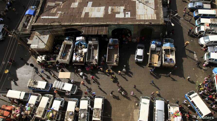 FILE - Trucks and commericial vehicles are unloaded at a Mercato market in Addis Ababa, Ethiopia, Sept. 11, 2015. As part of recent reforms efforts, Ethiopia has opened its logistics sector to foreign investors.