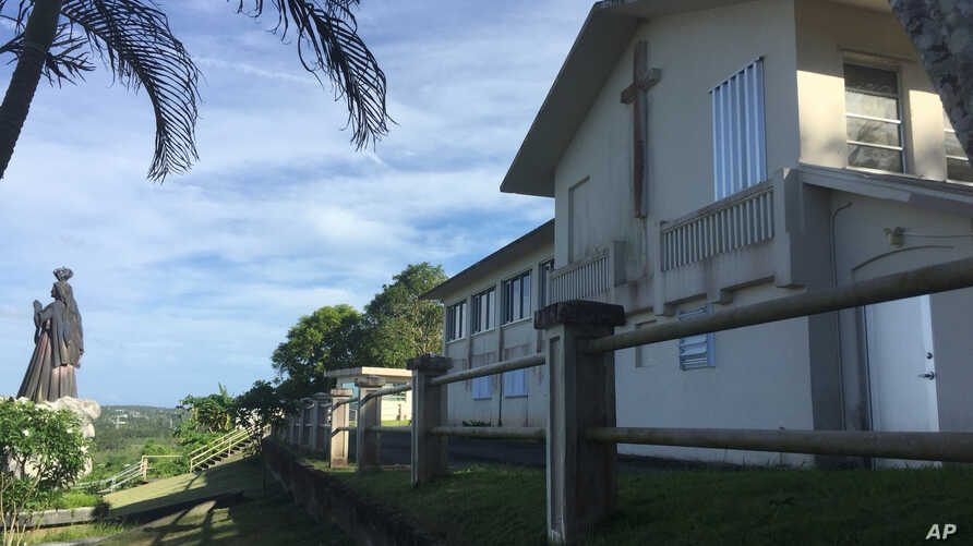 FILE - The residence and office of the Archbishop of Agana is seen in Hagatna, Guam, Nov. 7, 2018. Guam's Catholic Church has filed for bankruptcy, a move that will allow the archdiocese to avoid trial in dozens of child sexual abuse lawsuits and ent
