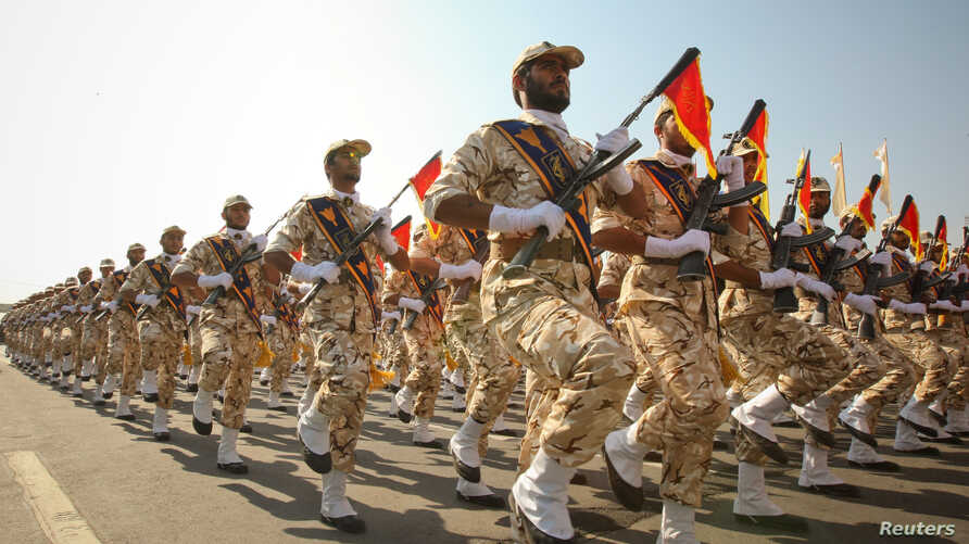 FILE - Members of the Iranian Revolutionary Guard march during a parade to commemorate the anniversary of the Iran-Iraq war (1980-88), in Tehran, Sept. 22, 2011.