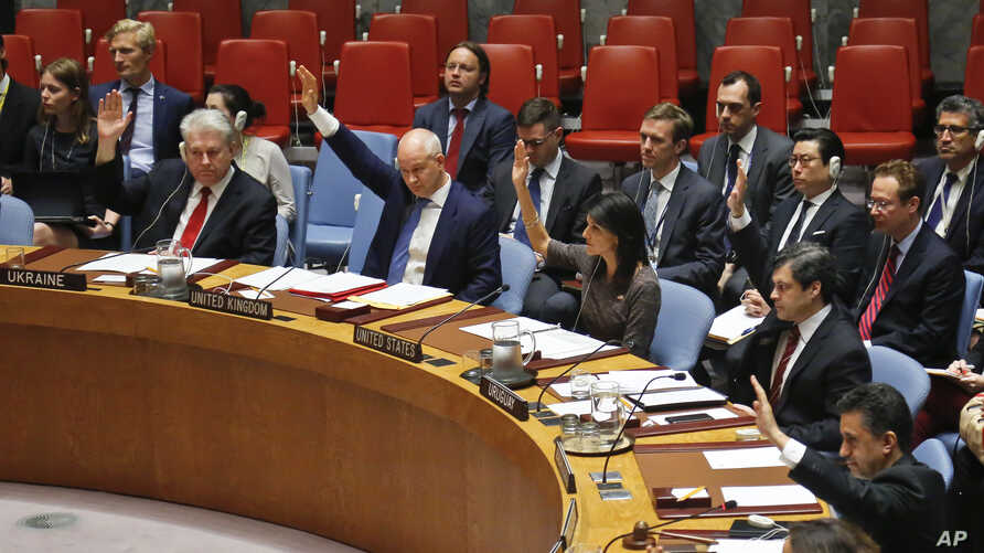 Ambassadors to the United Nations raise hands in a Security Council resolution vote to sanction North Korea at U.N. headquarters in New York, June 2, 2017.
