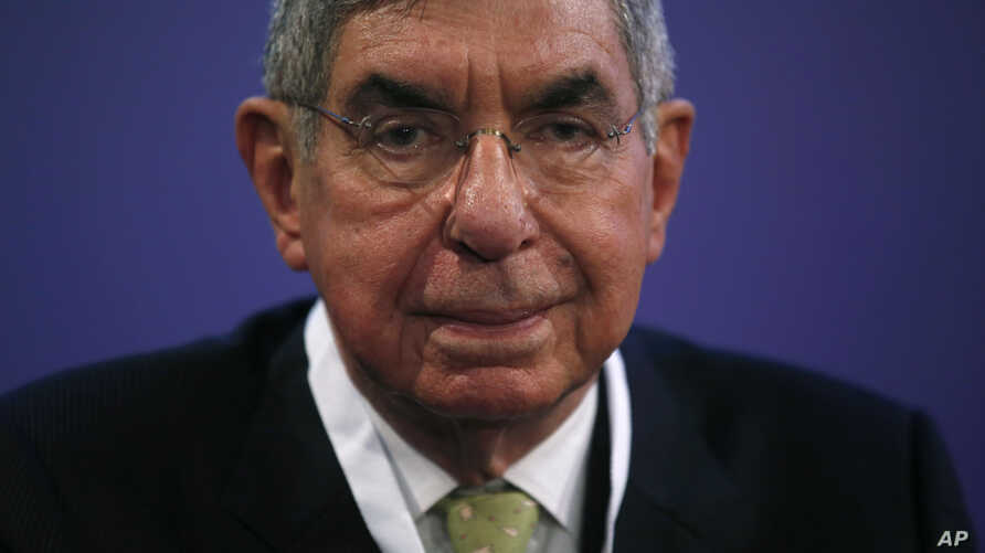 FILE - In this Nov. 13, 2015 file photo, Costa Rican 1987 Nobel peace laureate and former president of Costa Rica, Oscar Arias,  attends the opening ceremony of the XV World Summit of Nobel Peace Laureates at the University in Barcelona, Spain.