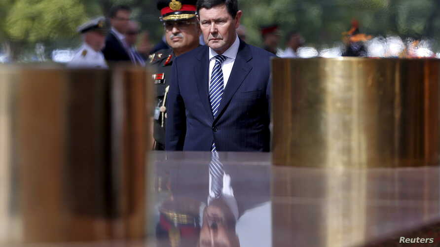 Australia's Defence Minister Kevin Andrews pays his respects at the India Gate war memorial in New Delhi, India, Sept. 2, 2015.
