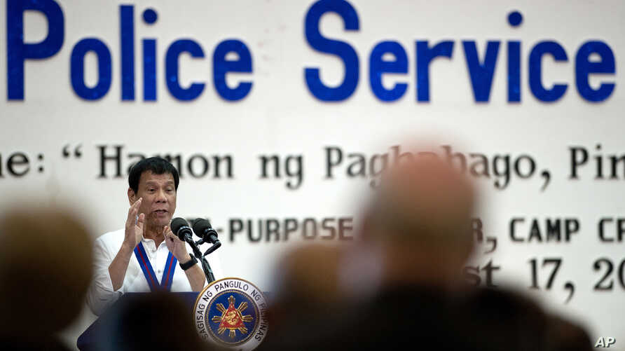 Philippine President Rodrigo Duterte gestures as he talks during the 115th Police Service Anniversary at the Philippine National Police (PNP) headquarters in Manila, Aug. 17, 2016.