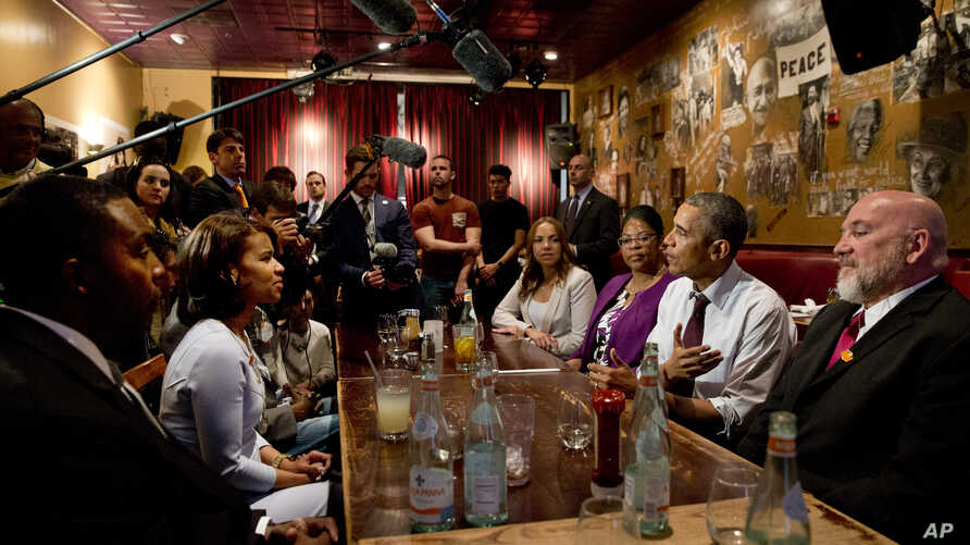 President Barack Obama meets with people who were formerly incarcerated and have previously received commutations, March 30, 2016, at Busboys and Poets restaurant in northwest Washington.