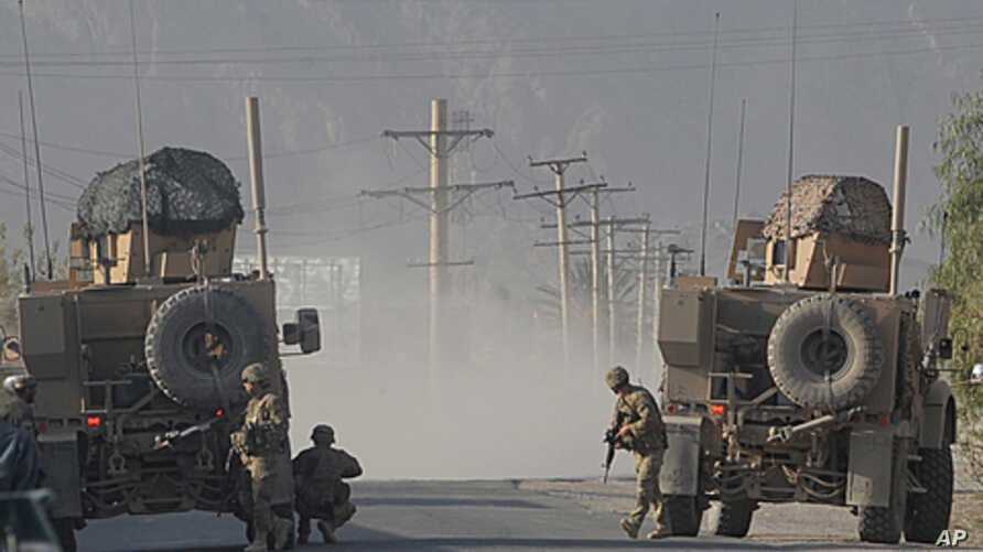 US soldiers keep watch on site during a gunfight near a US base in Kandahar on October 27, 2011.