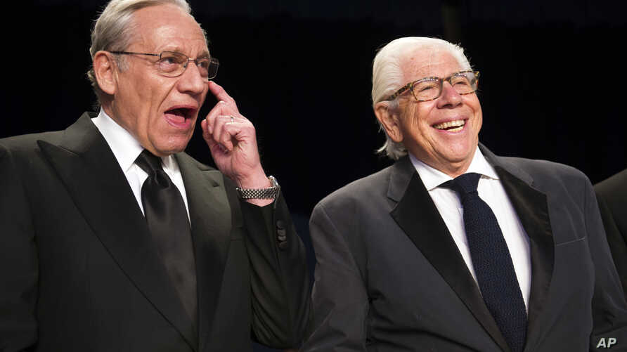 FILE - Bob Woodward, left, and Carl Bernstein appear at the White House Correspondents' Dinner in Washington, April 29, 2017.