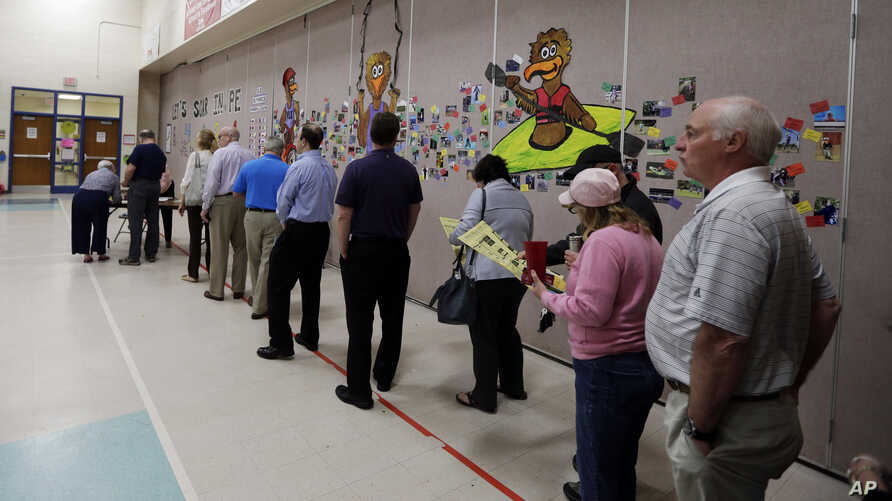 People line up to vote inside a precinct in Matthews, N.C., Tuesday, March 15, 2016. Voters in North Carolina, as well as Florida, Illinois, Missouri and Ohio will cast their ballots in primary elections today.