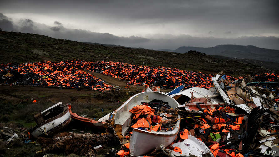 Wrecked boats and thousands of life jackets used by refugees and migrants during their journey across the Aegean sea lie in a dump in Mithimna, Greece, Feb. 19, 2016.