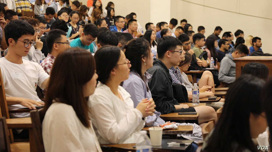 International students attend sessions about a number of things from health insurance policies to how Americans greet each other during their orientation week.