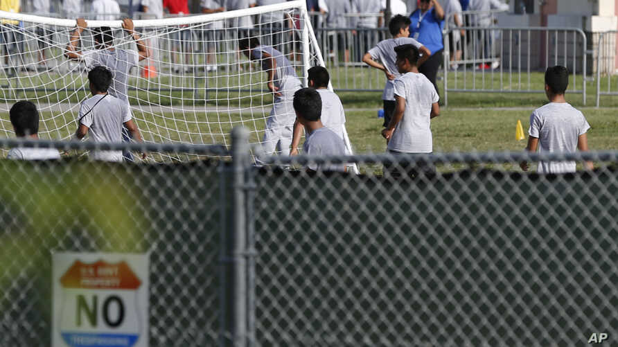 FILE- Immigrant children play outside a former Job Corps site that now houses them in Homestead, Florida, June 18, 2018. In a Wednesday, Nov. 28, letter to the heads of the Department of Health and Human Services and the Department of Homeland Securi