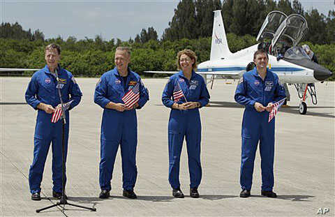 Atlantis [STS-135] crew members, from left, commander Chris Ferguson, pilot Doug Hurley, mission specialist Sandy Magnus and mission specialist Rex Walheim, speak to the media after arriving at the Kennedy Space Center in Cape Canaveral, Florida, Jul