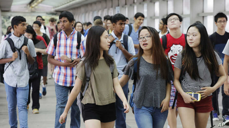FILE -  Students arrive for the first day of school at Stuyvesant High School in New York.