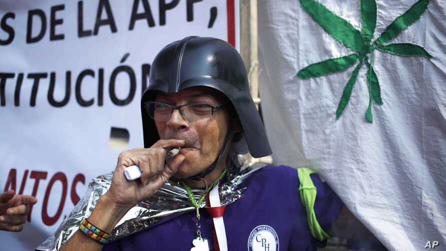 A supporter of the legalization of marijuana smokes outside the Supreme Court in Mexico City, Nov. 4, 2015.