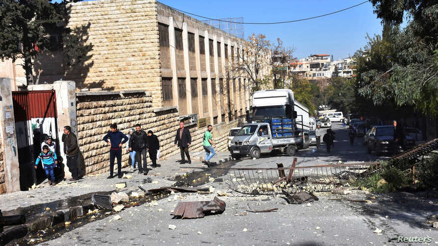 A view shows the damage outside a school after shelling by Syrian rebels on government-held western Aleppo, Syria, Nov. 20, 2016.