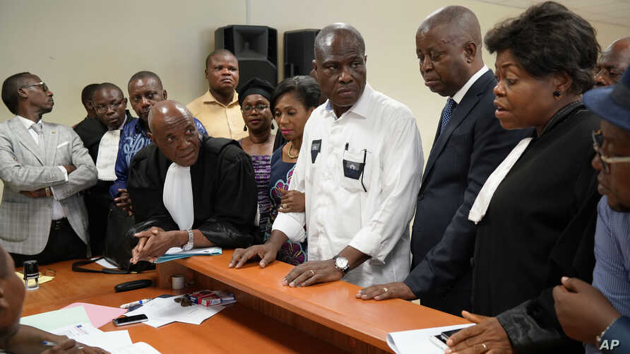 FILE - Accompanied by his wife and his lawyers, Congo opposition candidate Martin Fayulu, center, petitions the constitutional court following his loss in the presidential elections in Kinshasa, Congo, Jan. 12, 2019.