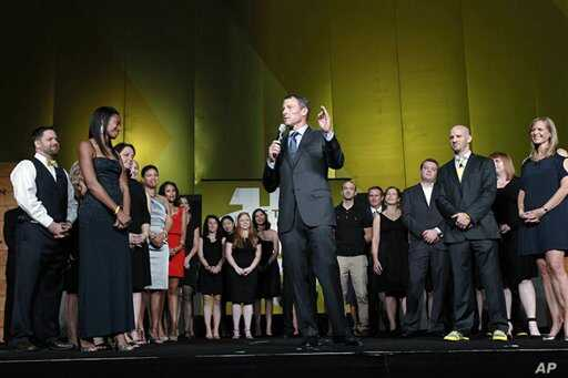 Lance Armstrong stands onstage during the 15th anniversary celebration for Livestrong, his cancer-fighting charity, in Austin, Texas, on October 19, 2012.