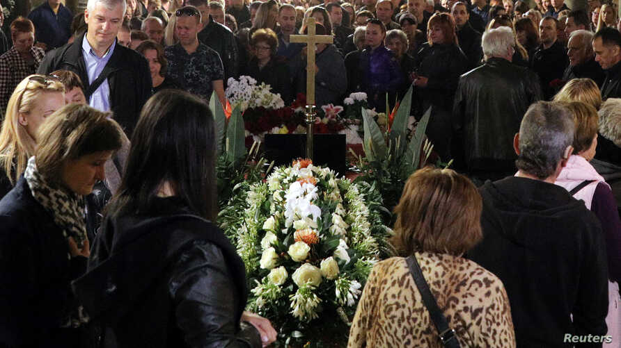 People attend the funeral service of killed Bulgarian journalist Viktoria Marinova in Sveta Troitsa (Holy Trinity) Cathedral in Ruse, Bulgaria, Oct. 12, 2018.