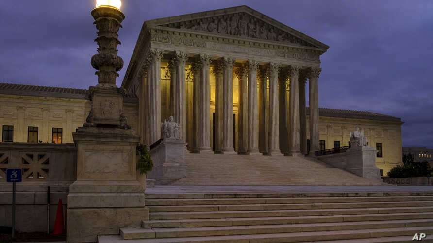The U. S. Supreme Court building stands quietly before dawn in Washington, Oct. 5, 2018.