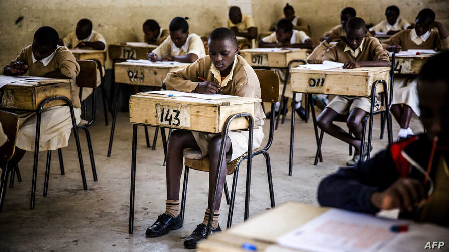 Pupils from the Mathare North Primary School take the Kenya Certificate of Primary Education (KCPE) exam after a return to daily life following post-election turmoil on October 31, 2017 in the Mathare slums of Nairobi, a stronghold of Kenyan oppositi