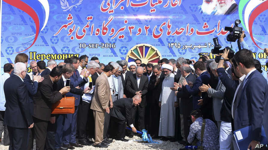 Mideast Iran NuclearIn this photo released by the official website of the Office of the Iranian Senior Vice-President on Sept. 10, 2016, the head of Russia's Federal Atomic Agency Sergei Kiriyenko breaks ground in a ceremony to begin building Iran's